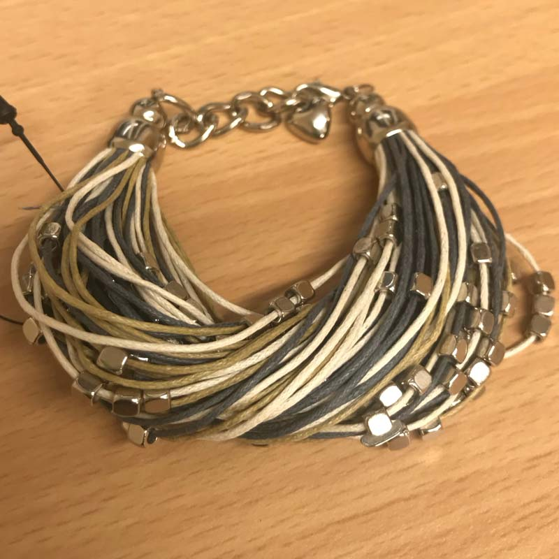 Multistrand and metal bracelet